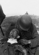 First aid for a German soldier wounded in the battle.