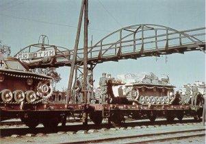 Stug IIIs being moved by rail through Lyubotin in the Ukraine.