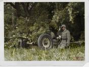 Troops manning a camouflaged 3.7 cm calibre PaK 36.