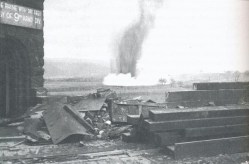 German bombs fall near the Ludendorff Bridge after it was captured by the U.S. Army.