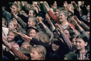 Happy and excited crowds saluting Germans at Schwarzach/St. Veith during Hitler's Austrian Anschluss referendum.