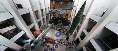 The new atrium, July 2014. The exhibits include a Supermarine Spitfire, a V-1 flying bomb, a V-2 rocket, a Harrier Jump Jet, and Jeremy Deller's Baghdad, 5 March 2007, the wreckage of a car destroyed by a bomb during the Iraq War.