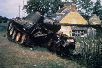 Knocked out Panther pushed to the side of the road somewhere in Normandy.