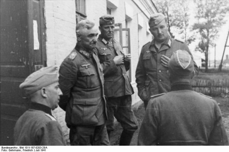 Lieutenant General von Hubicki, Commander of 9th Panzer Division and members of staff being briefed about the possibility that German airmen have been executed in the city of Lvov.