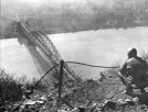 Dan Feltner of Company C., 656th Tank Destroyer Battalion, views the Ludendorff Bridge from the top of Erpeler Ley.