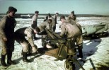 Regardless of the weather, the aircraft armorers were required to move enormous quantities of bombs daily to keep the Luftwaffe bombers, dive-bombers and fighter-bombers operational. While hydraulic bomb trolleys were available (an LWC trolley is seen here), they were often of little use on rain-softened Russian airfields and muscle power was the only option.