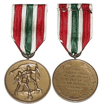 The medal's obverse (left) and reverse (right).