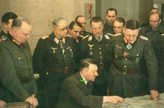 Theodor Busse (standing, far right) in a meeting with Hitler, March 1945.