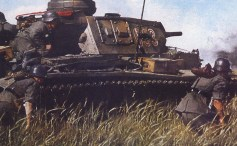 Panzer IV with Panzergrenadier on the move.
