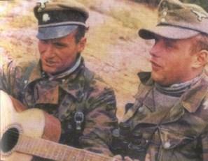 SS-Untersturmführer Franz-Josef Kneipp playing guitar with his comrade.
