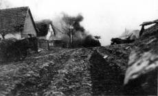 Series of five impressive photographs document an engagement at Polgardi on December 23, 1944. The Tigers 2 column rush through the town without adequate infantry support, and the lead panzer- Tiger 133 is hit by hidden anti-tank gun. The hit kills the driver and radio operator. The pictures were taken by Unteroffizier Lochmann, driver for the company commanders panzer of Heavy Panzer Battalion 503.