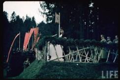 Reichskomissar Arthur Seyss-Inquart speaking at cornerstone laying, Münich-Salzburg autobahn during the Austrian Anschluss referendum , March 1938. Adolf Hitler is behind.