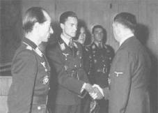 From left to right: Hartmann Grasser, Sayn-Wittgenstein shaking hands with Adolf Hitler, Günther Rall and Walter Nowotny at the Führerhauptquartier in Rastenburg on 22 September 1943.