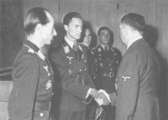 From left to right: Hartmann Grasser, Sayn-Wittgenstein shaking hands with Adolf Hitler, Günther Rall and Walter Nowotny at the Führerhauptquartier in Rastenburg on 22 September 1943.