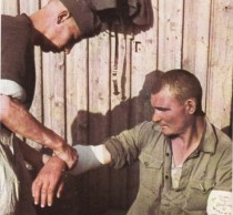 The man having his wound dressed is a volunteer out of the ranks of Soviet POWs.