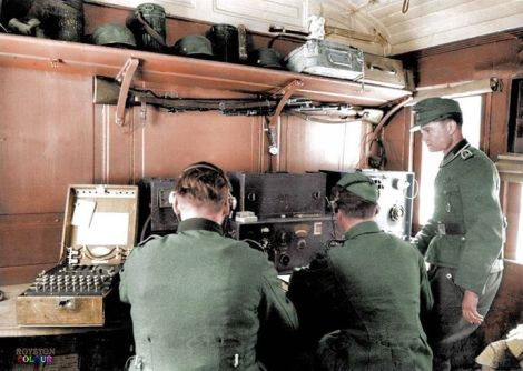 'Enigma' machine used in the communications room of a German troop train . The Enigma machine is on the left.