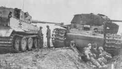 Tiger next to a knocked out KV tank.