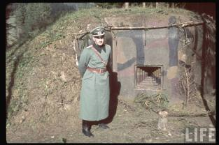 A German staff officer standing in front of ex-Czechoslovakian bunker in Sudetenland.