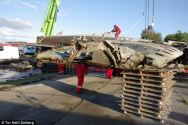 Wing section: Although showing some minor damage to the tips, the plane's wings appear strong despite decades in salty water Read more: http://www.dailymail.co.uk/news/article-2170817/German-seaplane-recovered-depths-fjord-70-years-sank-raising-hopes-fly-again.html#ixzz37ym4PGio Follow us: @MailOnline on Twitter   DailyMail on Facebook