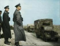 Erwin Rommel watching his troops moving, behind is one of his staff, Friedrich-Wilhelm von Mellenthin.