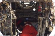 Restoration begins: A worker gets inside the plane, before it is placed in five fresh water tanks to be washed.