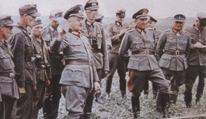 "Walter Model with General der Panzertruppe (later Generaloberst) Erhard Raus (with Deutsches Kreuz in Gold) and Generalleutnant (later General der Infanterie) Friedrich ""Fritz"" Schulz (2nd from right)."
