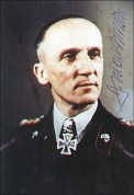 Hasso von Manteuffel in black panzer uniform with signature.