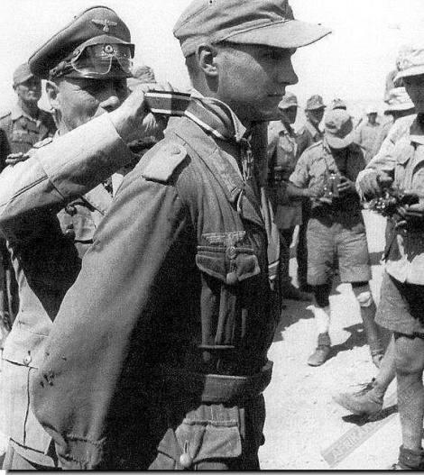 Field Marshal Erwin Rommel awards Günter Halm the Knight's Cross.