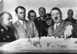 1936: German dictator Adolf Hitler (1889 - 1945) discussing plans for a new administration building for the provincial government in Weimar, Germany.Second from the left is Hitler's architect Albert Speer (1905 - 1981).
