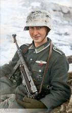 A young Unteroffizier (NCO - noncommissioned officer) armed with an MP 40 submachine gun in Russia, January 1944.
