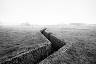 A brick trench runs through a field along the route of the Atlantic Wall (Atlantikwall in German).