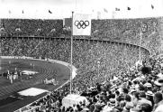 The Olympic Flag flying next to the Personal standard of Adolf Hitler over the Olympic Stadium, Berlin 1936.