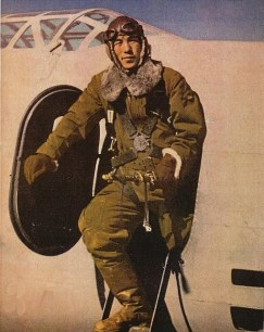 A Japanese army air force pilot with his Mitsubishi Ki-21 bomber aircraft ,1942.
