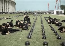 German SS men resting on the south lawn of the Olympic Stadium in Berlin, Germany, August 1936.