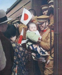 Japanese soldier smiling to a little children before leaving to the front in Manchuria, 1933.