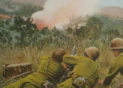 Japanese soldiers reloading a type 92 heavy machine gun during heavy fighting, South China 1939.