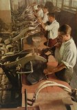 """Wehrmacht uniform factory - Men working on steam presses. photographs by Dr. Paul Wolff, used in the book """"Uniformen und Soldaten"""" by Curt Ehrlich - published in 1942. Featured is the uniform factory of Peek & Cloppenburg. Looks like he is shaping the collar."""