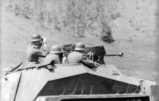 German soldiers fire the 2.8 cm sPzB 41 heavy anti-tank rifle on the Sd.Kfz. 250/11. The vehicle is assigned to the elite Großdeutschland Division engaged on the Eastern Front.