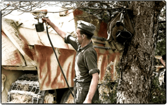 Spray painting camouflage on a Jagdpanther (Sd.Kfz.173) of 654 schwere Panzerjäger Abteilung in France in the spring of 1944.