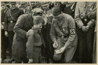 Germany Awakes. Group #32. Picture #207: Hitler gives his signature to a boy .