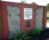 """Display of two sections of the wall and a """"You are leaving"""" sign at Fort Gordon, Georgia."""