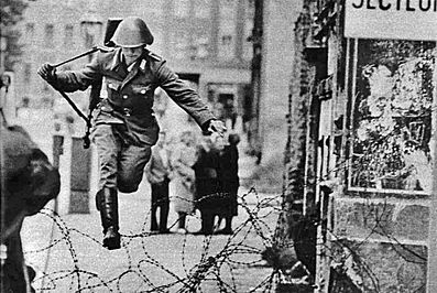 NVA soldier Conrad Schumann defecting to West Berlin during the wall's early days in 1961.