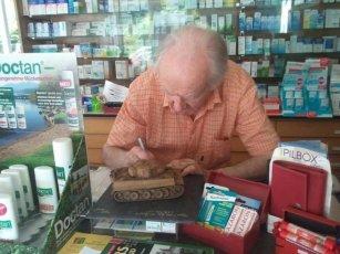 Otto Carius at his pharmacy - Tiger Apotheke.