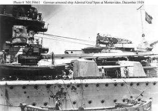 The Admiral Graf Spee in the port of Montevideo with a light hit on the port side aft.