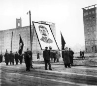 """For many modernist city planners, the destruction in Germany. In both East and West Germany, planners set about creating a """"break"""" from the past. Pictured her is the monumental boulevard Karl Marxallee (originally Stalinallee) in East Berlin. The demonstrators are marching on the occasion of Stalin's death in 1953."""