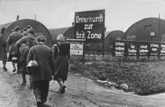 With such vast destruction, there was a severe shortage of apartments and living space in Germany immediately after the war. Many Germans had to live in Nissenhütten (in 1946). Others hold up in their largely destroyed homes. This particular camp was the temporary home of the German soldiers who had returned from the front.