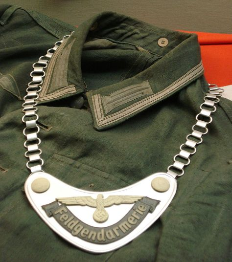 Uniform of a Feldgendarm during World War II, including the distinctive gorget.