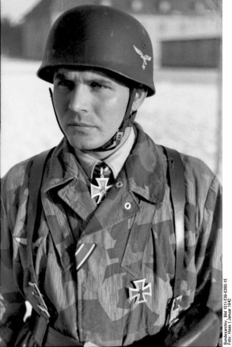 Fallschirmjäger Dr. Bruno Sassen wearing a Luftwaffe Fallschirmjäger helmet.