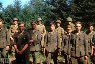"American troops stand guard behind young German Heer (Army) soldiers captured near the town of Le Gast during the Normandy invasion, June 1944. Although the branch color seems to not match up (happened often), it's a high chance that these guys are from Panzergrenadier-Regiment 156, part of the 116. Panzer Division ""Der Windhund""."