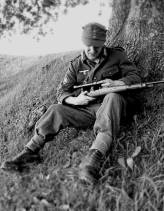 Gebirgsjäger with his Karabiner98k rifle. It looks as he cleans the front lens with his finger.